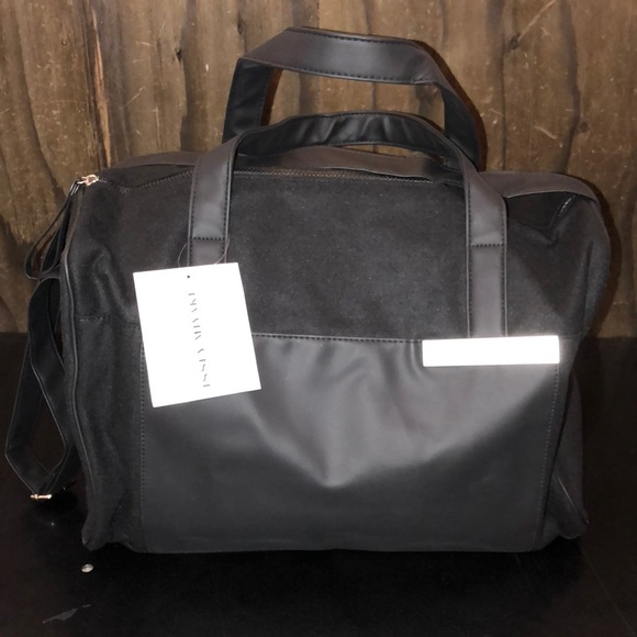 392d122952 Issey Miyake black fabric and leather duffel bag
